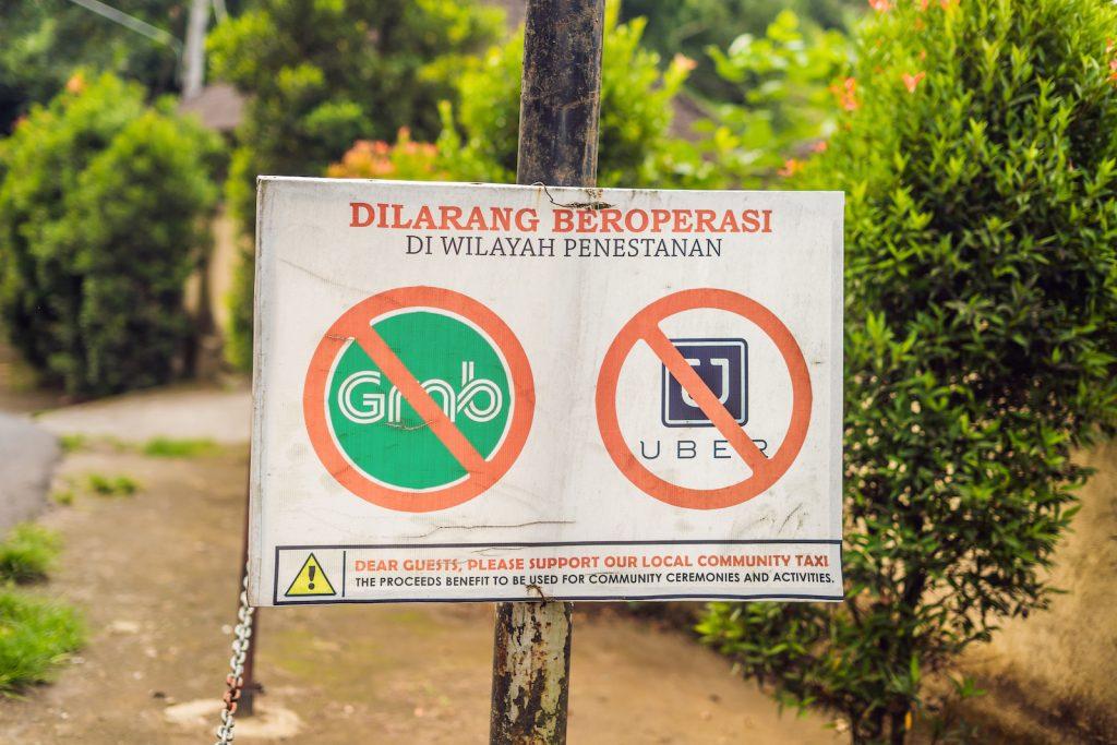A sign banning uber and grab - New Naratif