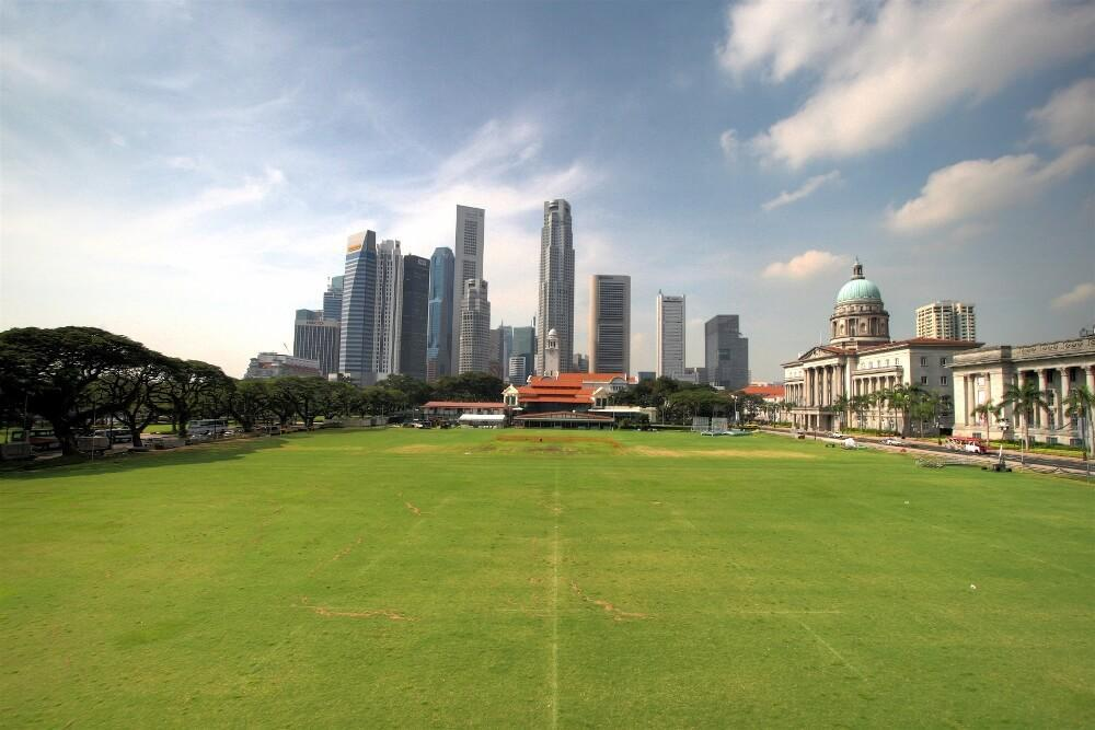 "Photograph of the European ""Open Square"" from Figure 1 & 2 today, as the modern civic district, picturing the Cricket Club, Victoria Memorial Hall and Theatre, the Supreme Court, and new high-rise buildings. - New Naratif"