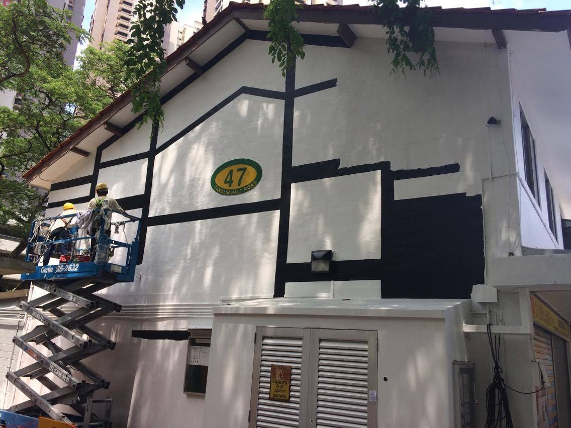 Modern HDB buildings being painted black and white. - New Naratif